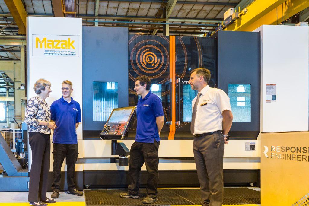 Prime Minister Theresa May discussing Responsive's Mazak machining.
